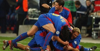 Basel celebrate their third goal against Liverpool