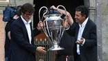 Ciro Ferrara and Careca escort the trophy through the streets of Naples