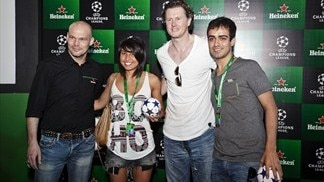 Fredrik Ljungberg and Steve McManaman pose for photos with fans on the Jakarta leg of the UEFA Champions League Trophy Tour