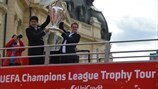 Ambassadors Miodrag Belodedici and Fabio Capello with the silverware on the bus