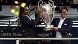 Ambassadors Christian Karembeu and Fabio Capello hold aloft the trophy during the UEFA Champions League Trophy Tour visit to Budapest