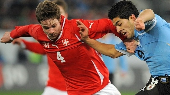 Switzerland stung by waspish Uruguay