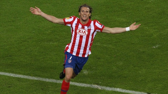 Forlán double gives Atlético glory