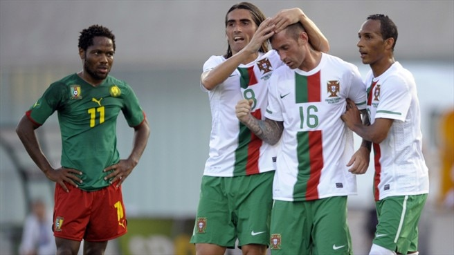 Portugal push Cameroon aside