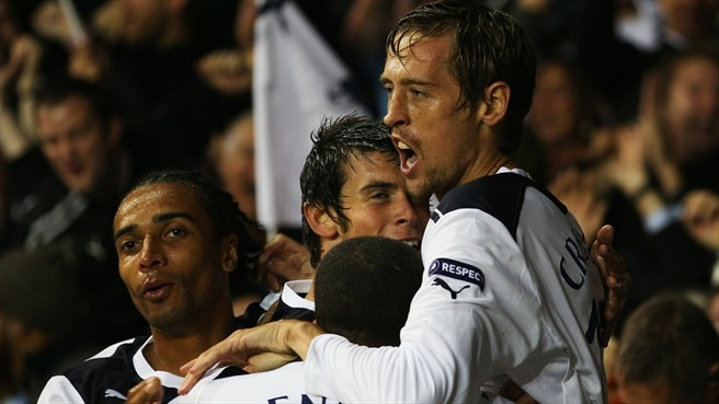 Crouch leads Spurs into promised land
