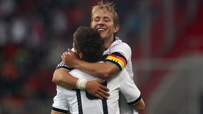 Holtby helps Germany sign off with victory