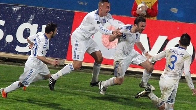 Greece back on top thanks to Torossidis