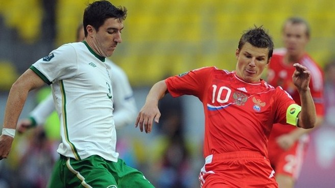 Stephen Ward (Republic of Ireland) & Andrey Arshavin (Russia)