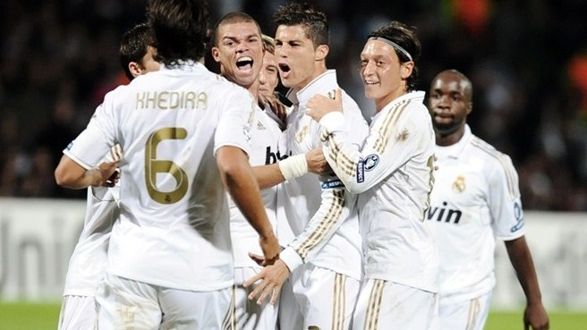 Ronaldo double puts perfect Madrid through