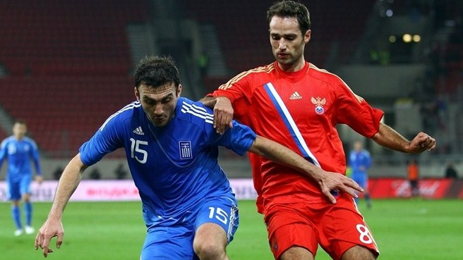 Greece recover to hold Russia in Piraeus