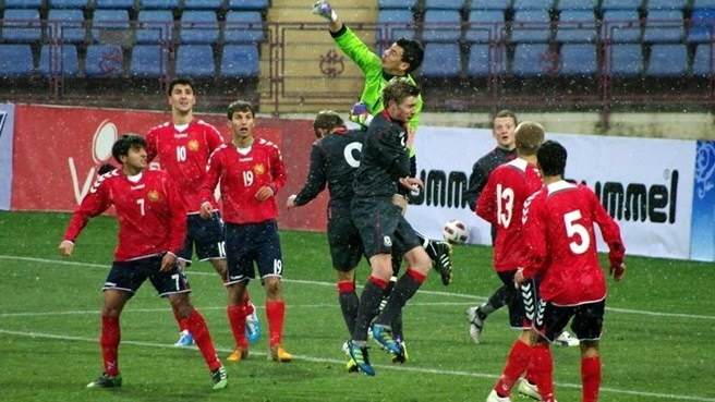 Armenia hold on after late Wales scares