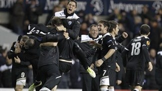 Ten-man PAOK advance thanks to Tottenham win