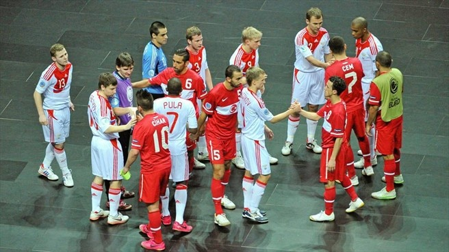 Russia and Turkey players shake hands