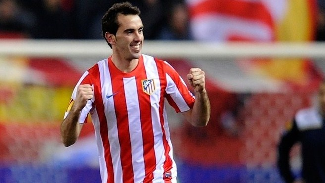 Godín heads Atlético to second Lazio success