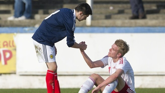 Scotland and Denmark players shake hands