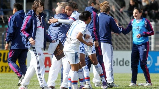 Olympique Lyonnais players celebrate