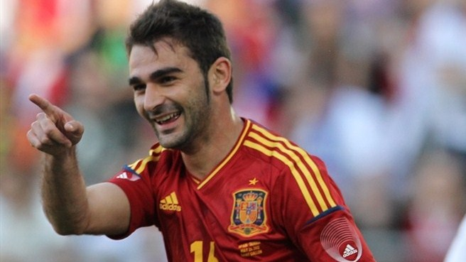 Holders Spain prepare with Serbia win