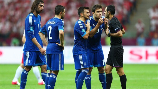 Referee Carlos Velasco Carballo & Sokratis Papastathopoulos (Greece)