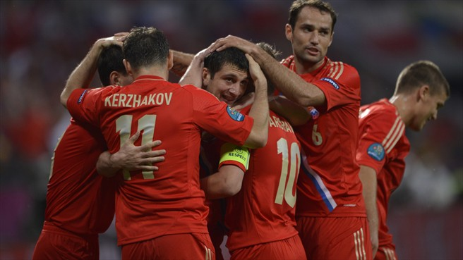 Dzagoev double helps Russia to flying start