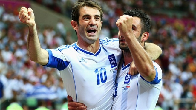 Karagounis fires Greece into last eight