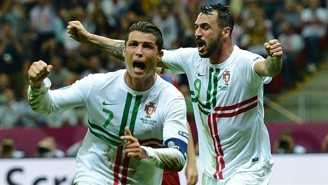 Ronaldo heads Portugal into last four