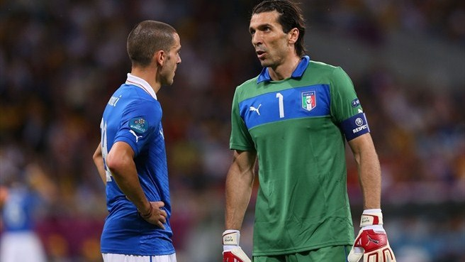 Italy bow out with heads held high