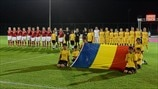 Denmark and Romania players line up