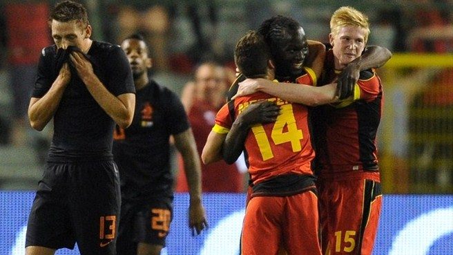 Mertens lifts Belgium to comeback win
