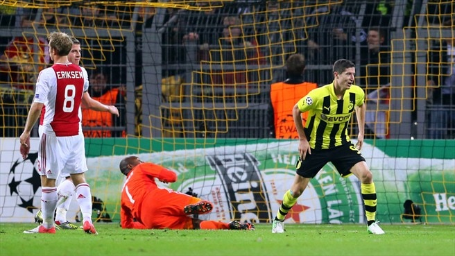 Leaders Dortmund face Amsterdam factor