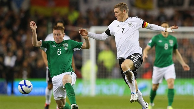 James McCarthy (Republic of Ireland) & Bastian Schweinsteiger (Germany)