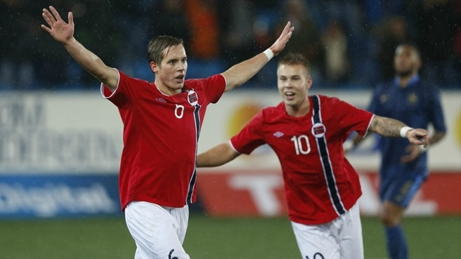 Norway progress after eight-goal thriller