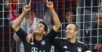 Claudio Pizarro (left) celebrates one of his three goals against LOSC