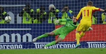 Gabriel Torje scores Romania's winner from the penalty spot