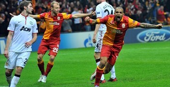 Felipe Melo (right) celebrates Burak Yılmaz's headed goal