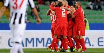 Jordan Henderson is congratulated on his winner for Liverpool