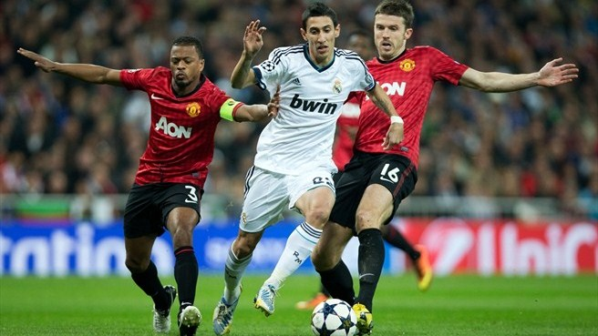 Patrice Evra & Michael Carrick (Manchester United FC), Ángel Di María (Real Madrid CF)