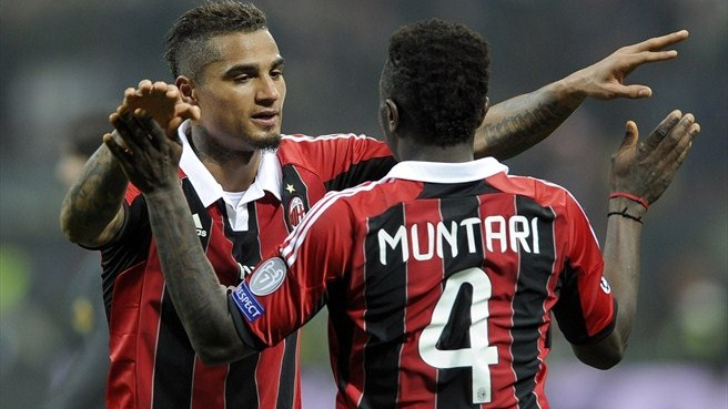 Milan goalscorers Kevin-Prince Boateng and Sulley Muntari celebrate the victory