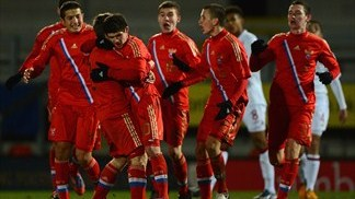 Russia edge out England, Portugal