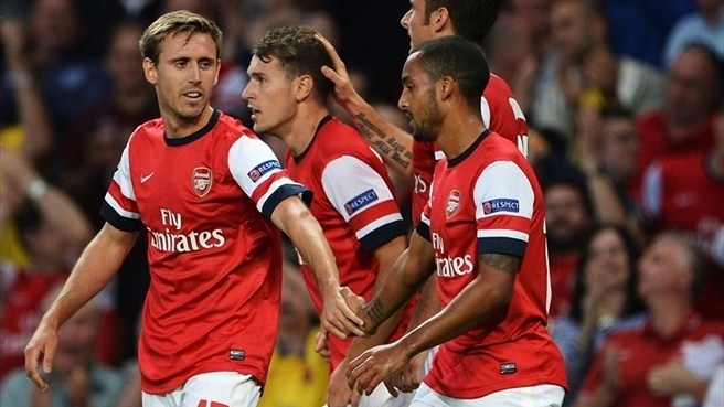 Ramsey at the double as Arsenal breeze through