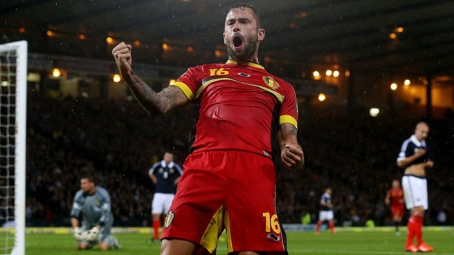 Belgium defeat Scotland to close in on Brazil