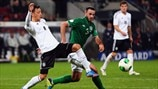 Mesut Özil (Germany) & Marc Wilson (Republic of Ireland)