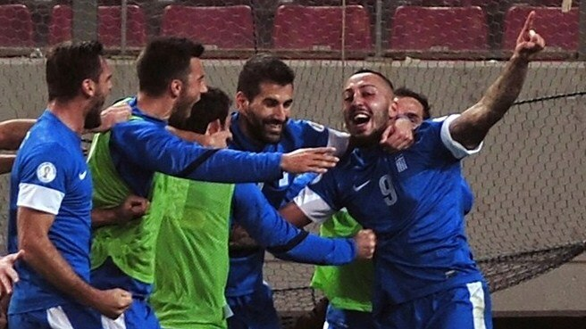 Greece halfway to Brazil after Romania win