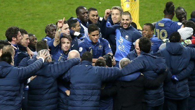 Display of unity takes France to Brazil