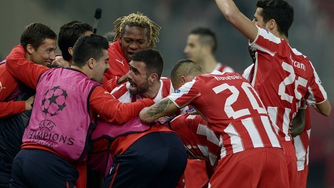 Míchel flying but keeps Olympiacos grounded