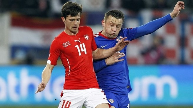 Croatia keep pace with Switzerland