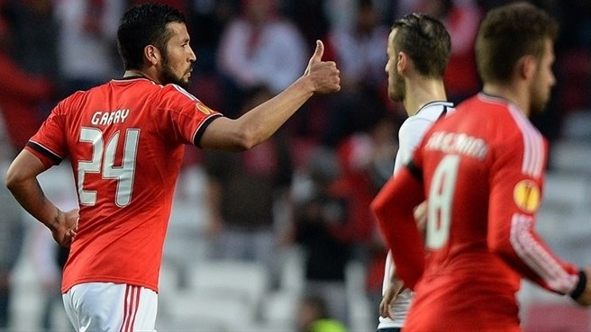 Benfica squeeze past valiant Spurs