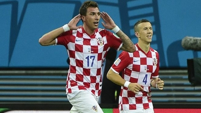 Croatia cruise past ten-man Cameroon