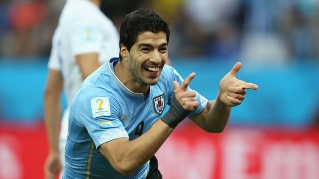 England sunk by Suárez double for Uruguay