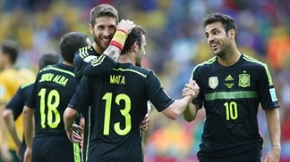 Villa helps Spain bow out with a convincing win