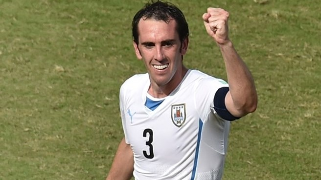 Godín heads ten-man Italy towards the exit